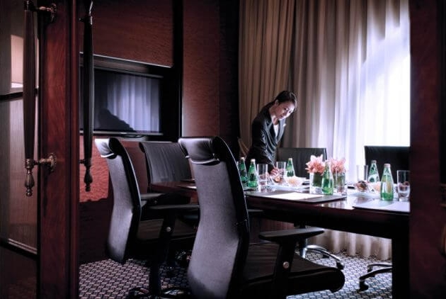 Image of a person setting up a boardroom