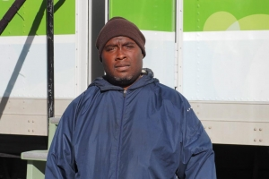 Jameel Milligan outside a mobile shower provided by Clean the World