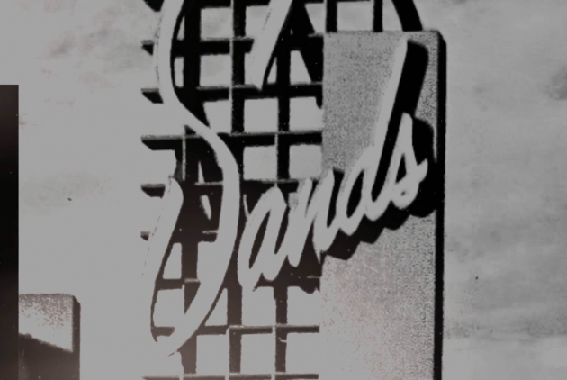Black and white photo of an old Sands logo